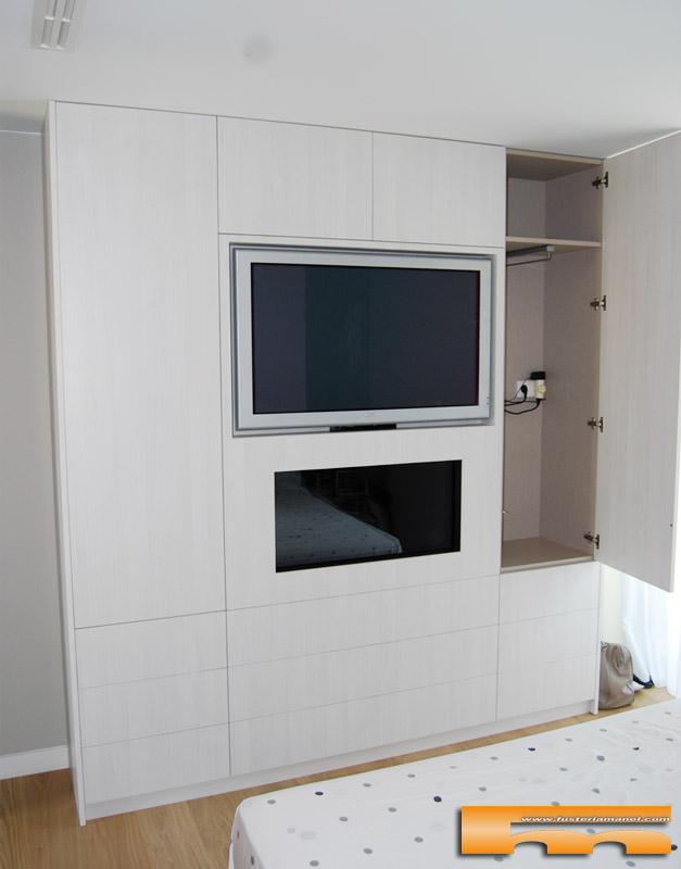 Armario con chimenea y tv caldes laura - Salones con chimenea y television ...